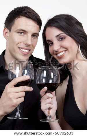 Young couple enjoy red vine, at home,