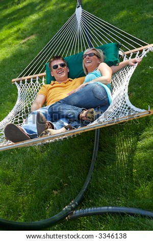 Young couple enjoying a hammock
