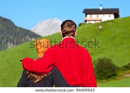 Young couple enjoying a mountains view - stock photo