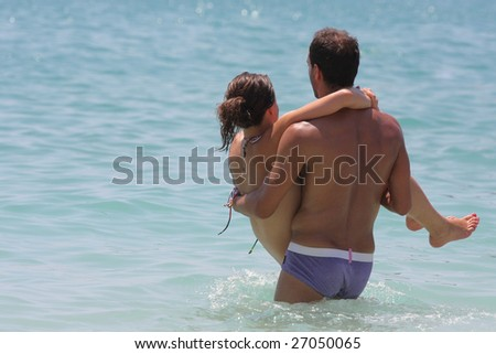 Young couple enjoying a swimming pool in Greece