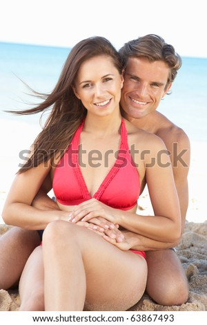 Young Couple Enjoying Beach Holiday