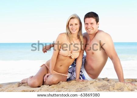 Young Couple Enjoying Beach Holiday - stock photo