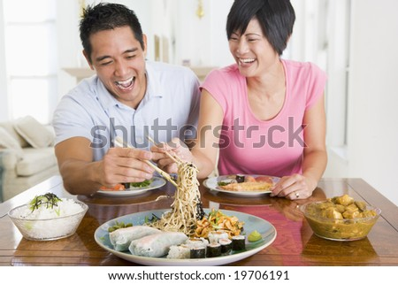 Young Couple Enjoying Chinese Food - stock photo