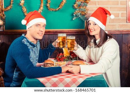 Young Couple Enjoying Christmas Dinner - stock photo