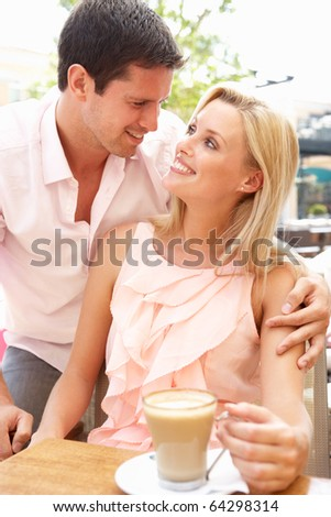 Young Couple Enjoying Coffee In Cafe - stock photo