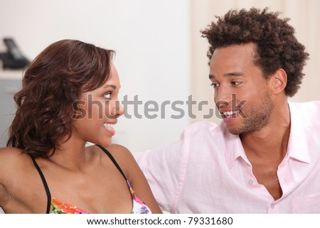 Young couple enjoying day-off at home - stock photo