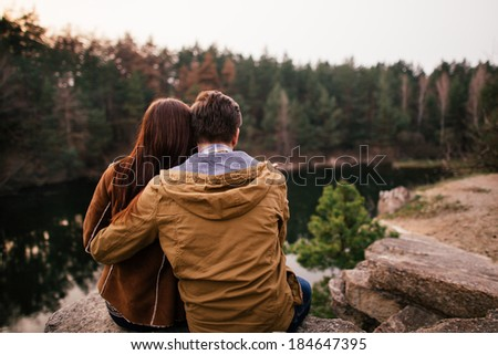 Young couple enjoying lake panorama - stock photo