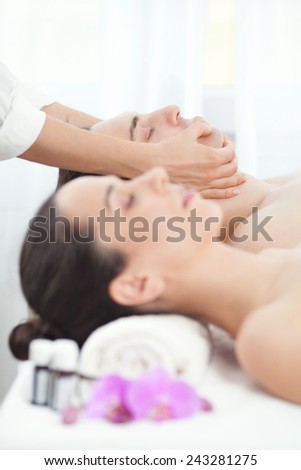 Young couple enjoying massage at the spa  - stock photo