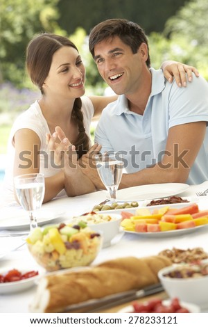 Young Couple Enjoying Meal Outdoors