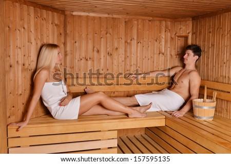 Young couple enjoying sauna  - stock photo