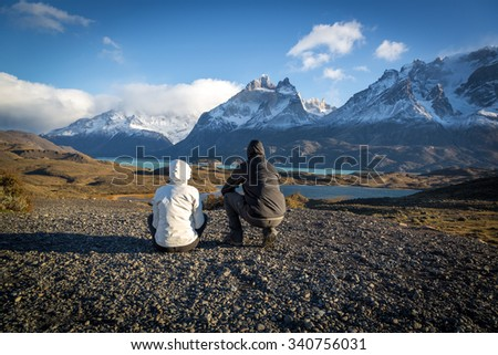 Young couple enjoying the a beautiful scenario in Torres del Paine National Park, Patagonia, Chile - stock photo