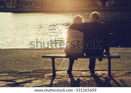 Young couple enjoying the sunset - stock photo