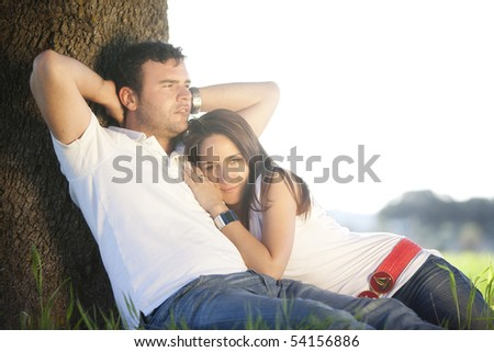 Young couple enjoying their love outside. - stock photo