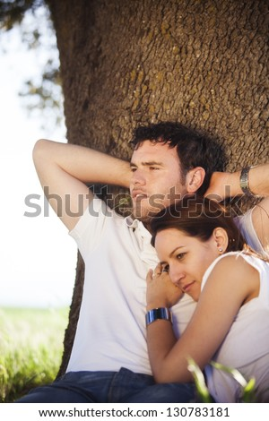 Young couple enjoying their love outside. Focus on the man. - stock photo