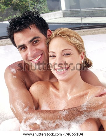 Young couple enjoying together in a jacuzzi. - stock photo