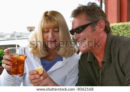 Young couple enjoys a meal outdoors in the Harbor.