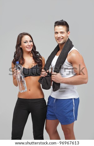 Young couple exercise together - stock photo