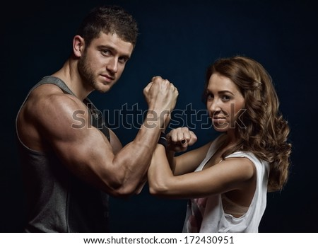 young couple exercising in the gym - stock photo