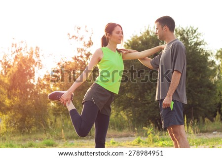 Young couple exercising together - stock photo