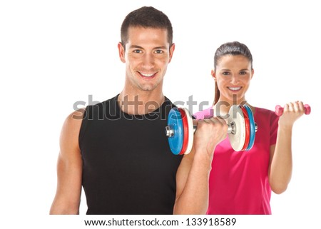 Young couple exercising with weights together. Young man and woman lifting weights. Isolated on white - stock photo