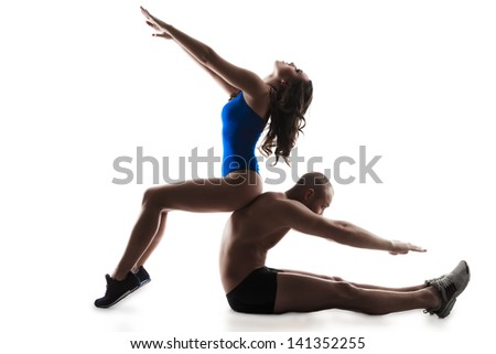 Young  couple exercising workout aerobic fitness posture full length silhouette on studio isolated on white background  - stock photo