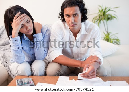 Young couple experiencing financial problems - stock photo