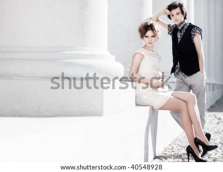 Young couple fashion. Bright white colors.