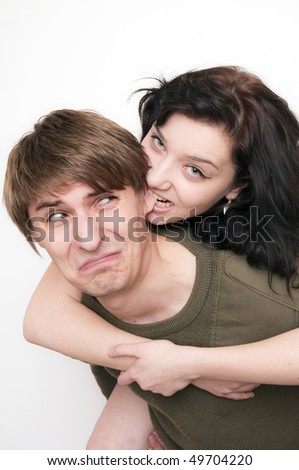 Young Couple Fight, she bite his ear - stock photo