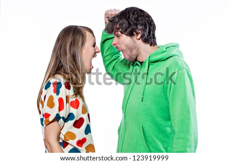 Young couple fighting and yelling on each other - stock photo