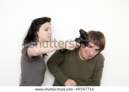 Young Couple fighting, she hit him with a camera - stock photo