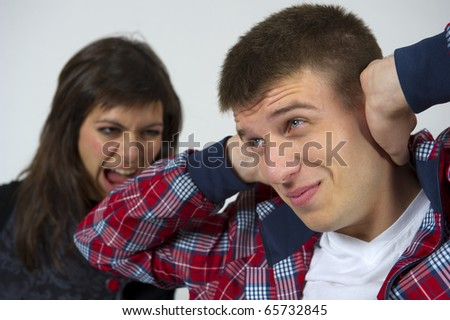 Young couple fights. over neutral background - stock photo