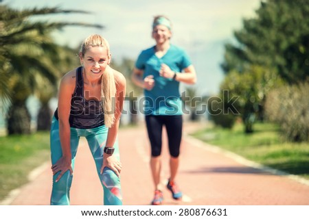 Young couple finishing jogging distance - stock photo