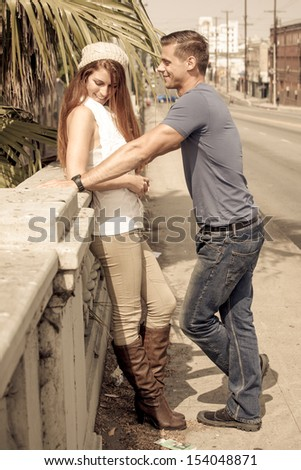 Young Couple Flirting in the city of Los Angeles, California - stock photo