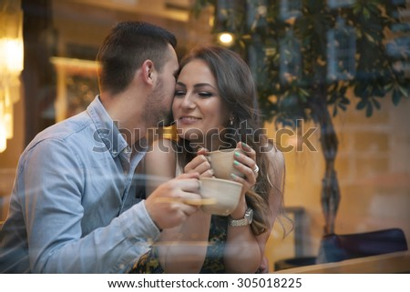 young couple flirting  on a date in cafe - stock photo