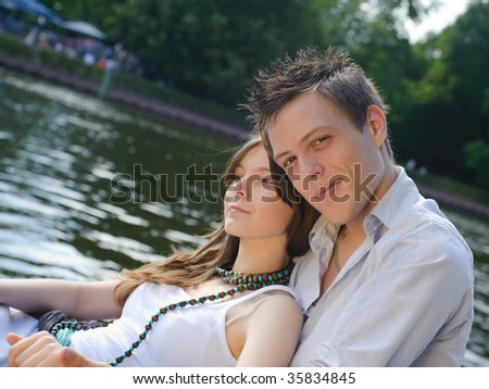 young couple flirting on the river