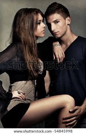 young couple flirting, studio shot