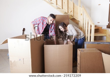 young couple furnishes the new home - stock photo
