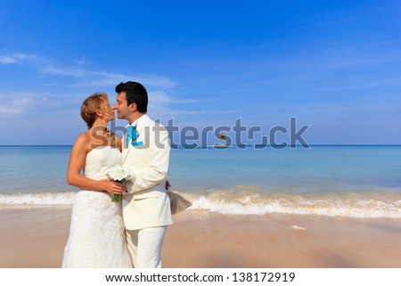young couple get married on the beach in Thailand