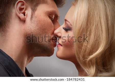 young couple getting ready to kiss - stock photo