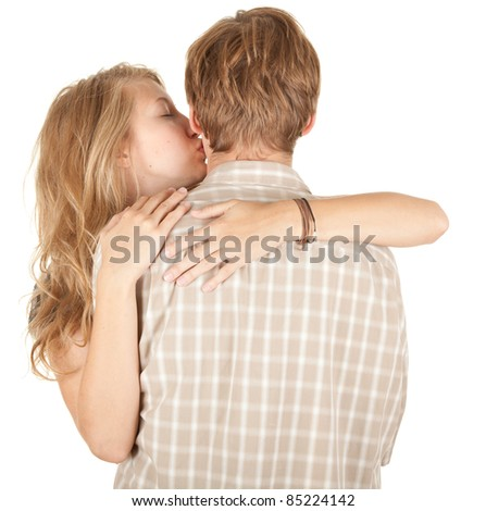 young couple - girl kissing his boyfriend, white background - stock photo