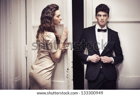 Young couple going out - stock photo