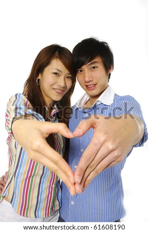 Young couple hands making heart shape-close up - stock photo