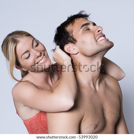 young couple happy smiling portrait naked in studio on isolated gray background - stock photo