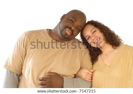 Young couple happy to be together, cuddling and touching heads - stock photo