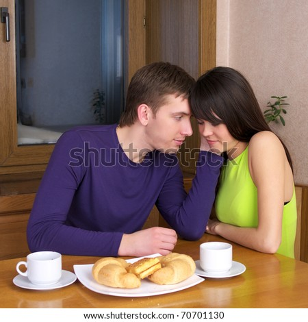 Young couple have a breakfast at home kitchen - stock photo