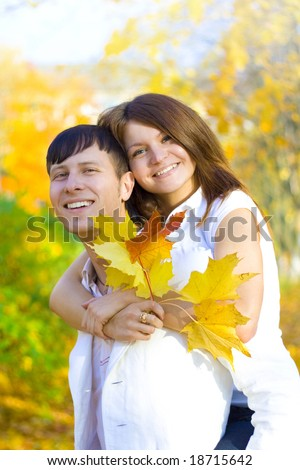 young couple have fun in autumn park - stock photo