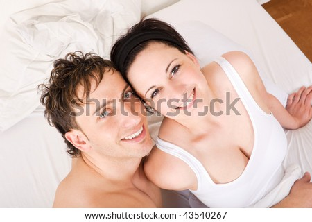 Young couple  have some fun in the bed - stock photo