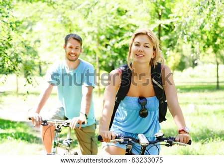 Young couple having a bike ride in nature