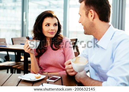 Young couple having a conversation over a cup of coffee - stock photo