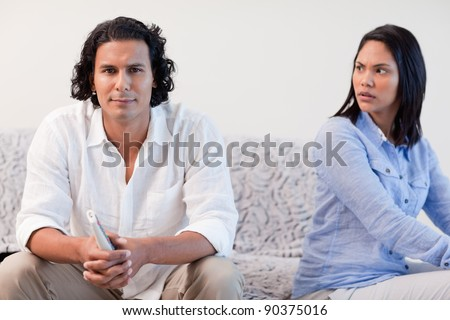 Young couple having a dispute in the living room
